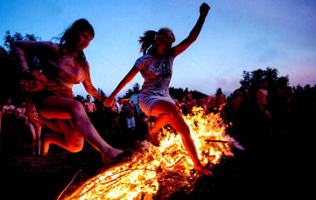 omsk region russia 9th july 2017 girls jump over a bonfire during JGNRBM